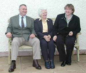 Rob Hayes, Christine Hayes and Janice Weetch try out the Geoff Hayes memorial bench